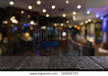 Wood Table For Display Your Product With Blur Background Of Pub Restaurant