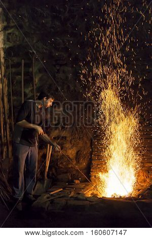 Biscay, SPAIN - JULY 25, 2015:  Blacksmith working at the forge in Biscay, Spain on July 25, 2015