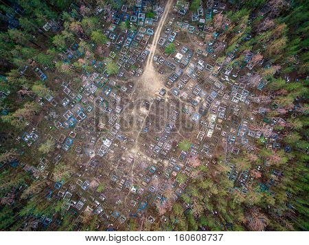 Cemetery in the forest, view from a copter in Russia
