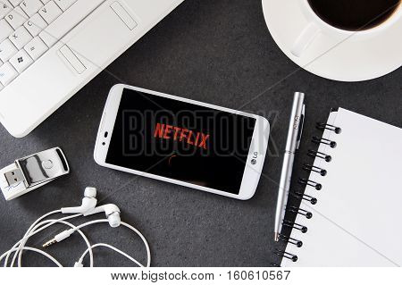 WROCLAW POLAND - DECEMBER 06th 2016: LG K10 with Netflix application laying on desk. Netflix provides streaming media and video on demand online and DVD by mail.