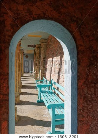 This archway reveals benches and some interior detail of the Bristol Colonnade at Portmeirion Wales.
