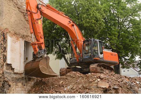 Demolition work of a house by a shovel dredge - Construction site old building