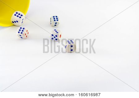 dices are coming out of yellow cup in action