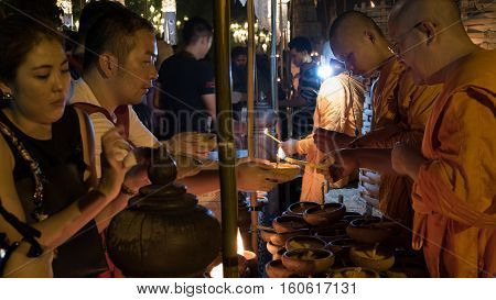 Monk Light Candle For People In Yeepeng Or Loy Krathong Festival