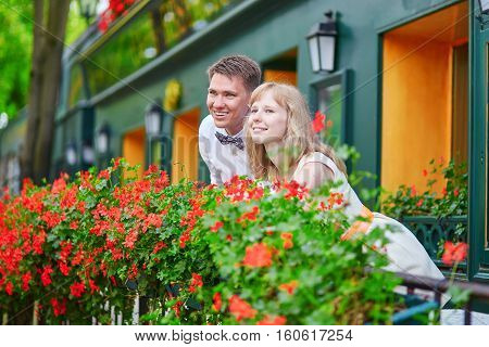Young Couple On A Balcony Of Their House