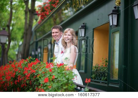 Happy Young Newly-wed Couple On A Balcony