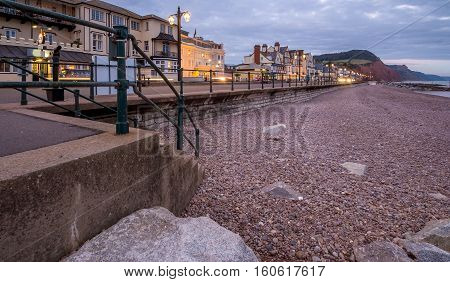 Embankment in Sidmouth. Low tide. Evening illumination. Devon. England