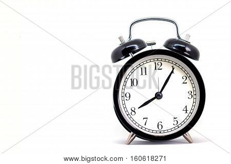 Vintage black clock Eight hours 5 minutes isolated on white background with copy space and clipping path