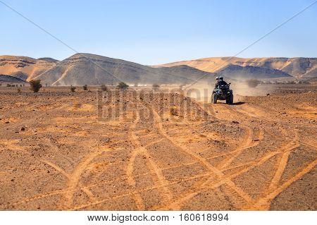 tourist piloting a quad in the Moroccan desert