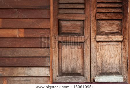 Old wooden window and plank wall background