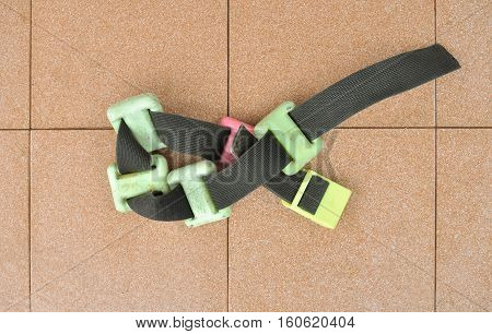 Scuba diver weight belt on the cotta tile