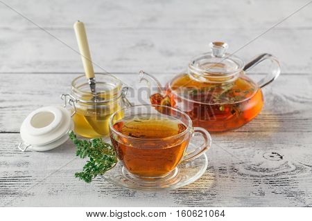 Thyme Tea With Fresh Bunches Thyme, Thyme Inside Teacup, White Background