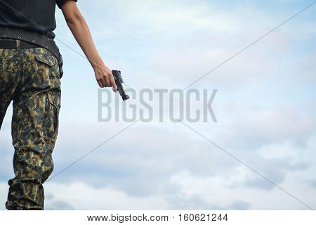 Soldier stand on the rock in nature background