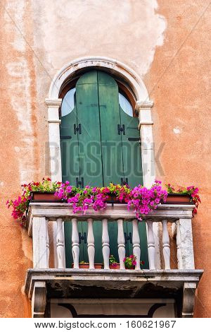 Ancient Italian architecture and colorfully decorative balcony in Venice Italy.