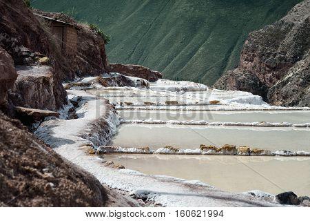 The Maras salt ponds located at the Peru's Sacred Valley Urubamba Peru