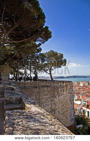 View over Lisbon, Portugal and the river from the historic Sao Jorge castle. Protector of the city.