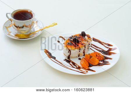 fruitcake with chocolate and orange and a cup of tea