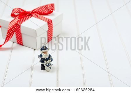 Christmas gift box on the white wooden backround. Winter holidays concept.