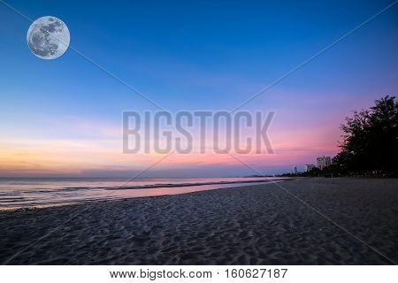 beautiful sunset sunrise background on the beach with super moon
