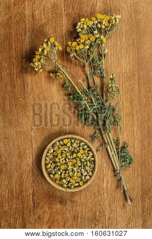 Tansy. Dried herbs for use in alternative medicine spa herbal cosmetics herbal medicine preparing infusions decoctions tinctures powders ointments butter tea bath.