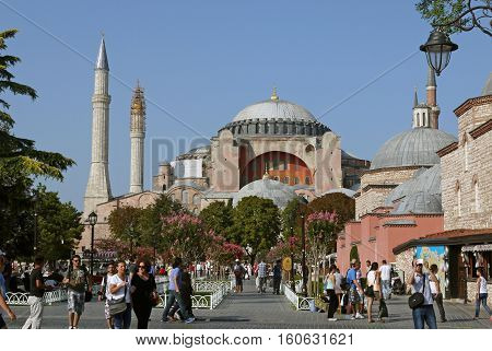 ISTANBUL - AUGUST 17: Tourists visit Hagia Sophia on August 17, 2014 in Istanbul, Turkey. Hagia Sophia is a former Orthodox patriarchal basilica, later a mosque and now a museum.
