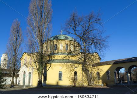 MUNICH GERMANY - NOV 28 2016: chapel of famous West cemetery of Munich Germany with historic gravestones most famous is grave of persian queen Soraya.
