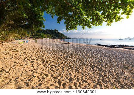 Tropical sea shore os the Ao Phrao beach in Ko Mook island, Thailand