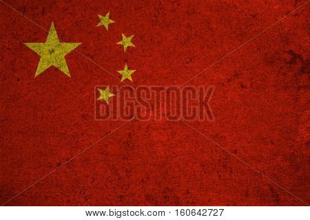 The Peoples Republic Of China Flag On An Old Grunge Background
