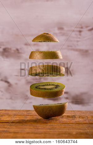 Single Kiwi Fruit Cut To Slices Which Floating Over Each Other