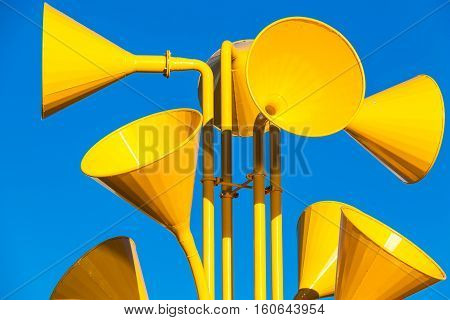 Many Bright Yellow Loudspeakers