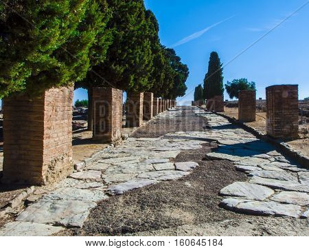 Ancient Roman road in Italica. Street in the Roman ruins of Italica. Santiponce. Sevilla. Spain.