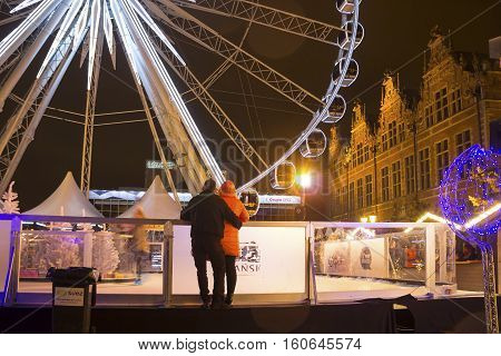 GDANSK, POLAND - DECEMBER 3, 2016: People enjoy visiting Christmas market with ferris wheel and ice rink