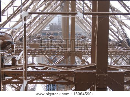 Eiffel Tower inside. Look into Eiffel Tower an engineering masterpiece, January 11, 2014, Paris, France