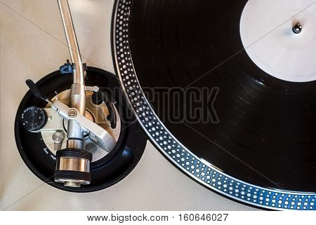 Close-up view of clean vintage turntable arm with counterweight