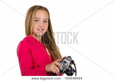 Young girl holding a vintage SLR camera isolated on a white background