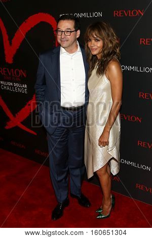 NEW YORK-DEC 01: Revlon CEO Fabian Garcia (L) and Halle Berry attend Revlon's 2nd Annual Love Is On Million Dollar Challenge Finale Party at The Glasshouses on December 1, 2016 in New York City.