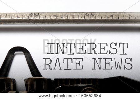 Interest rates headline printed on an old typewriter poster