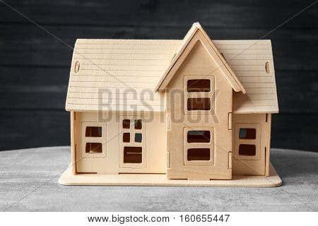 Plywood toy house on dark background