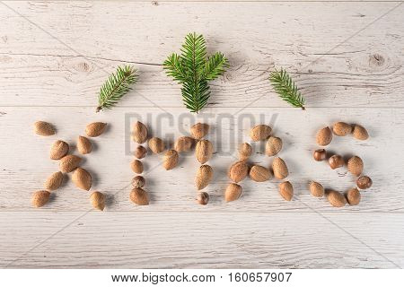 Wrote Xmas Text With Almond On Wooden Background