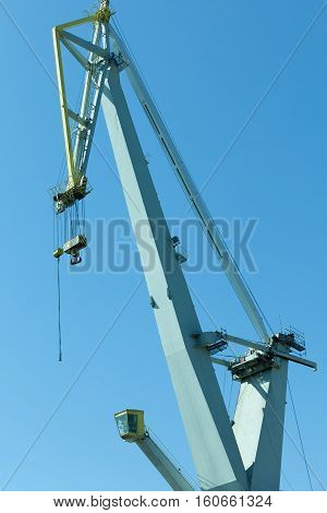 Business and commerce. Heavy load dockside cranes in port cargo container yard. Industrial scene
