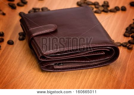 brown leather man purse on wooden background