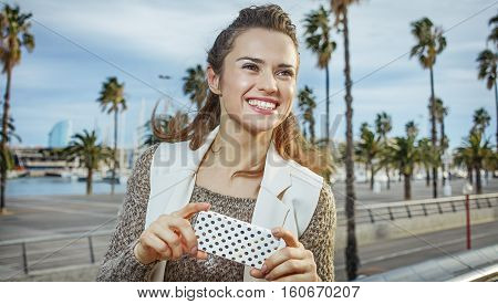 Smiling Trendy Fashion-monger In Barcelona, Spain Writing Sms