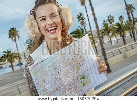 Happy Young Tourist Woman In Barcelona, Spain With Map