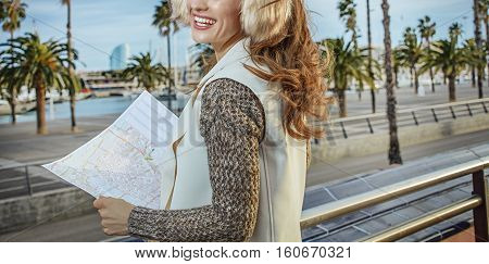 Traveller Woman On Embankment In Barcelona Looking Into Distance