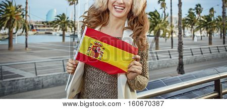 Tourist Woman On Embankment In Barcelona, Spain Showing Flag