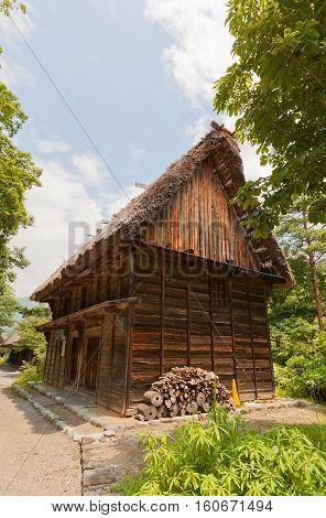 OGIMACI JAPAN - AUGUST 01 2016: Former Nakano Youshimori storage shed (moved from Kazura circa 19th c.) in Ogimachi gassho style village of Shirakawa-go district. World Heritage Site of UNESCO