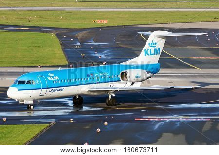 DUSSELDORF GERMANY - DEC 21 2015: KLM Cityhopper Fokker F70 taxiing after landing at Dusseldorf Airport.