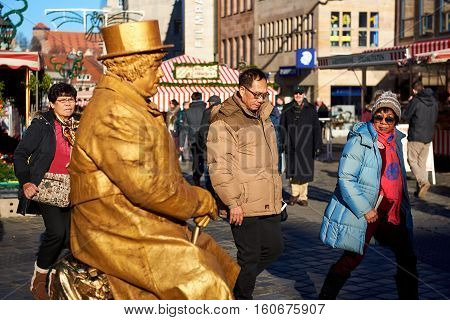 Nuremberg Germany - November 29 2016: Living statue in the most famous Christmas Market in Nuremberg city Germany. Living statues are the entertainment for the tourists