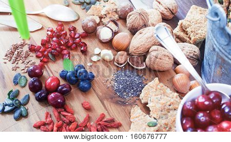 Superfood: variation of superfoods on wooden background
