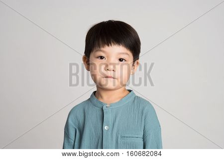 5 year old Asian man child's studio portrait shoot - isolated